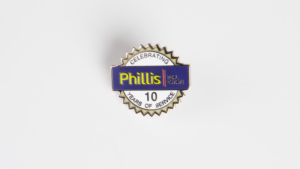 10 years of service metal pin badge.