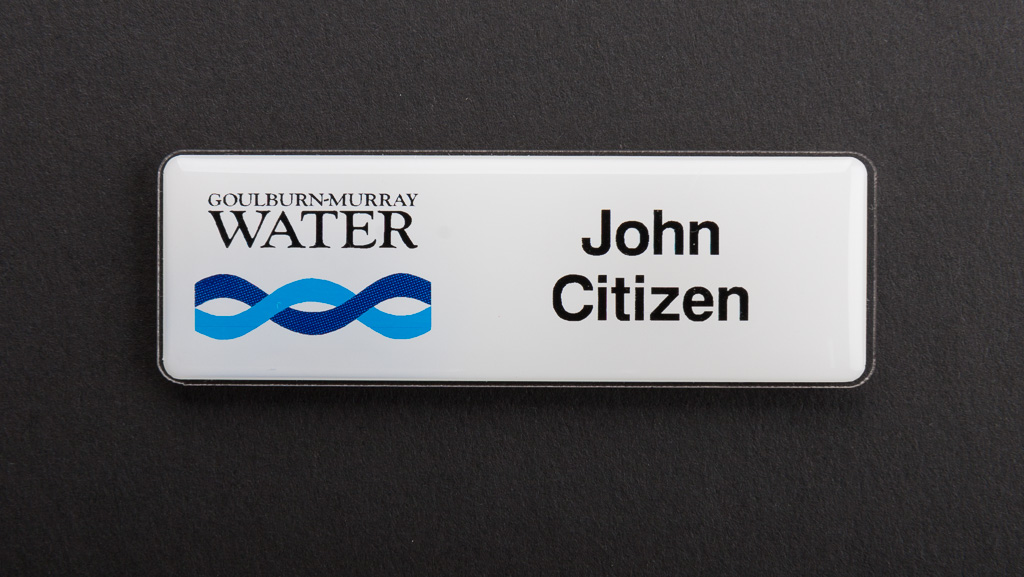 A white corporate name badge