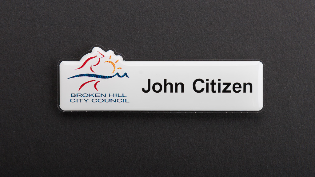A white name badge in a customized shape for broken hill city council