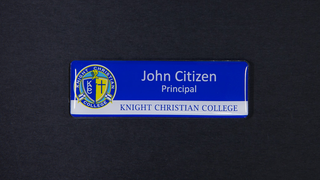 A blue name tag for Knight Christian College