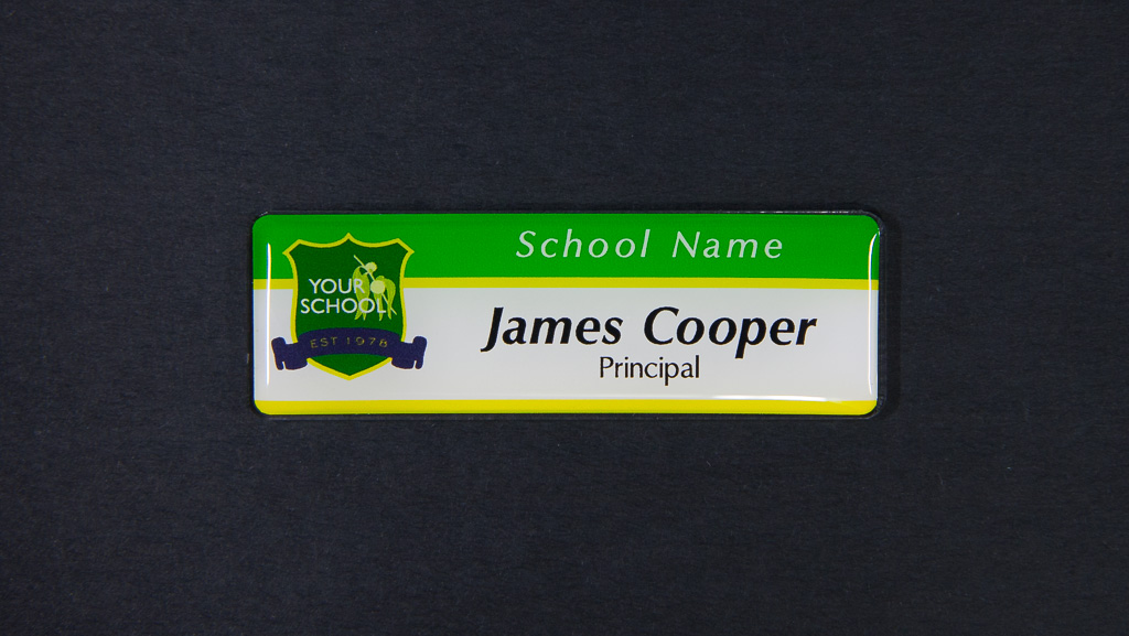 A green and white, with yellow lines name badge