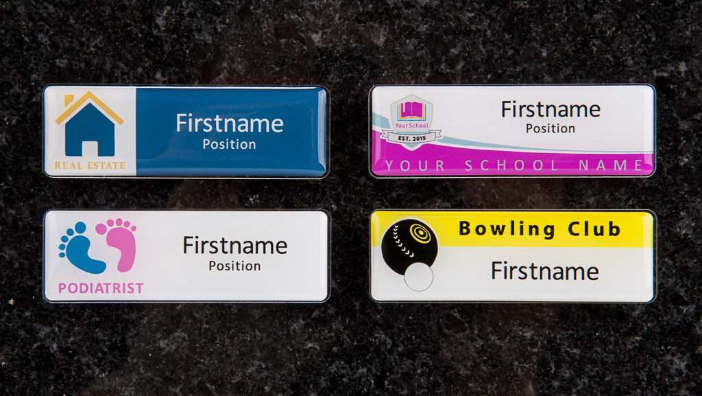 Four name badge designs