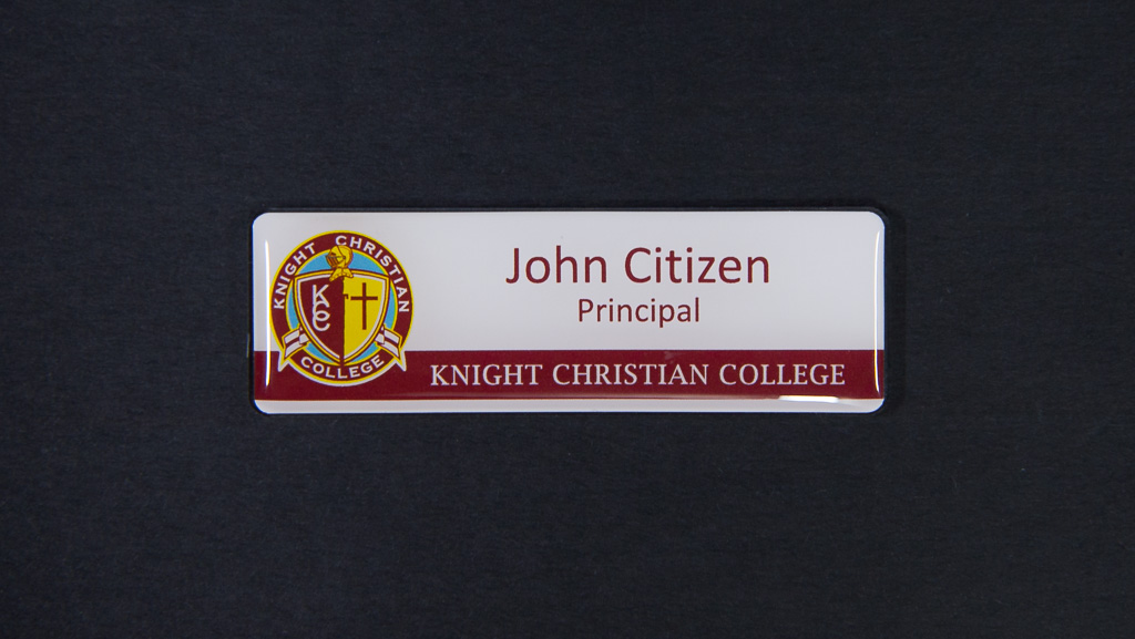 A white and maroon name tag