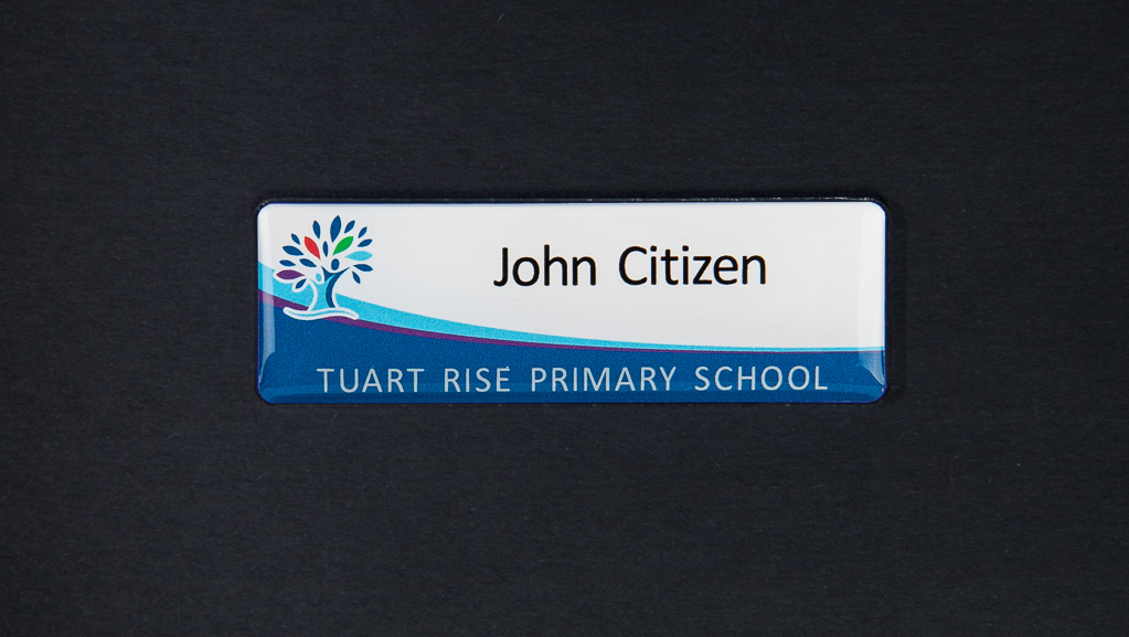 A standard white and blue name badge
