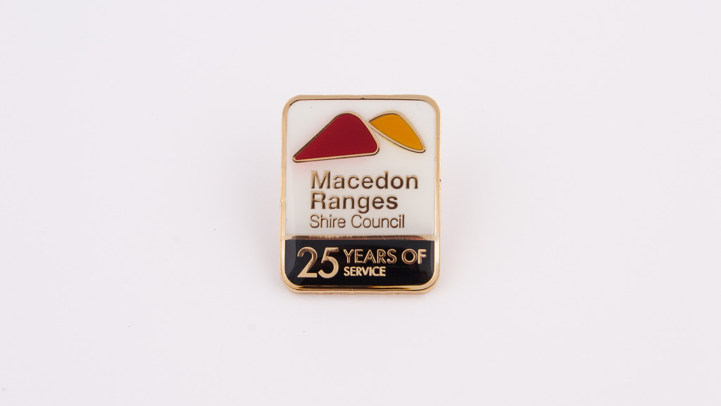 Custom made metal badge for 25 Years of Service.