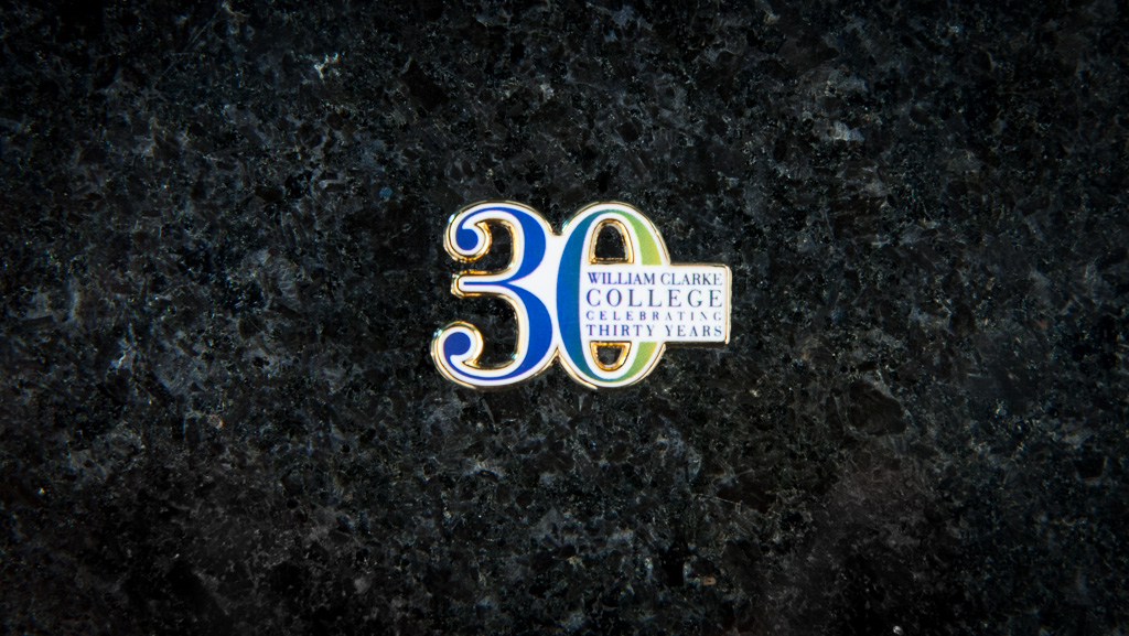 "3D letters for ""30"" along with the school's logo on the metal badge."