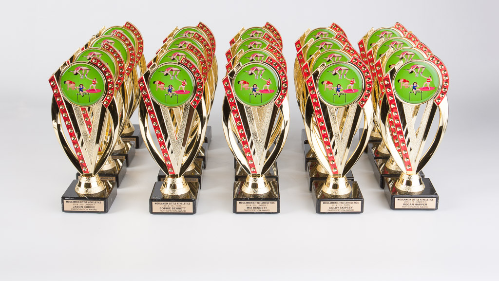 A bunch of personalised athletics sporting trophies.