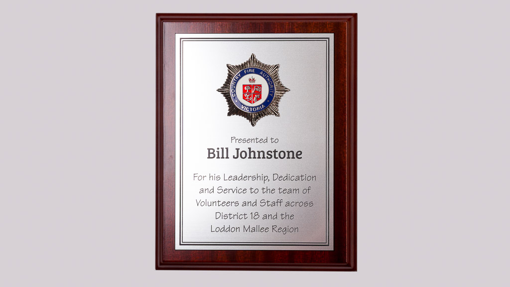 Country Fire Authority leadership, dedication award plaque. Award plaque lasered engraved laminate with metal badge