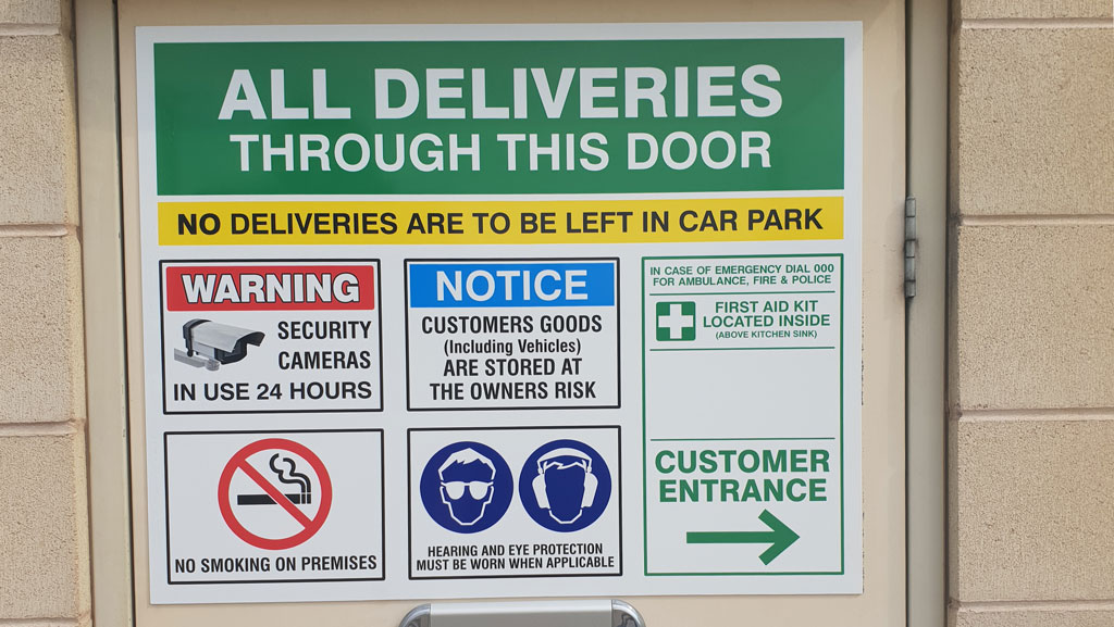 Custom safety sign for factory entrance door.