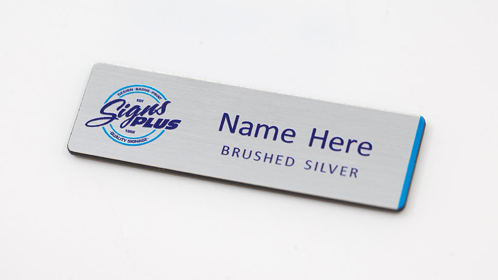 A brushed silver flat name badge with you own logo.