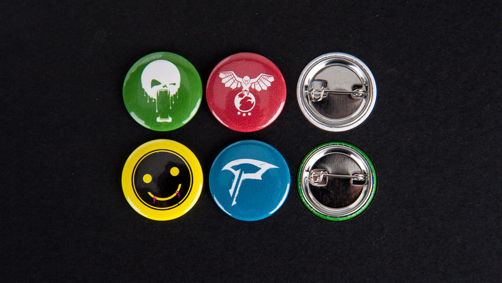 Small button badges with custom designs