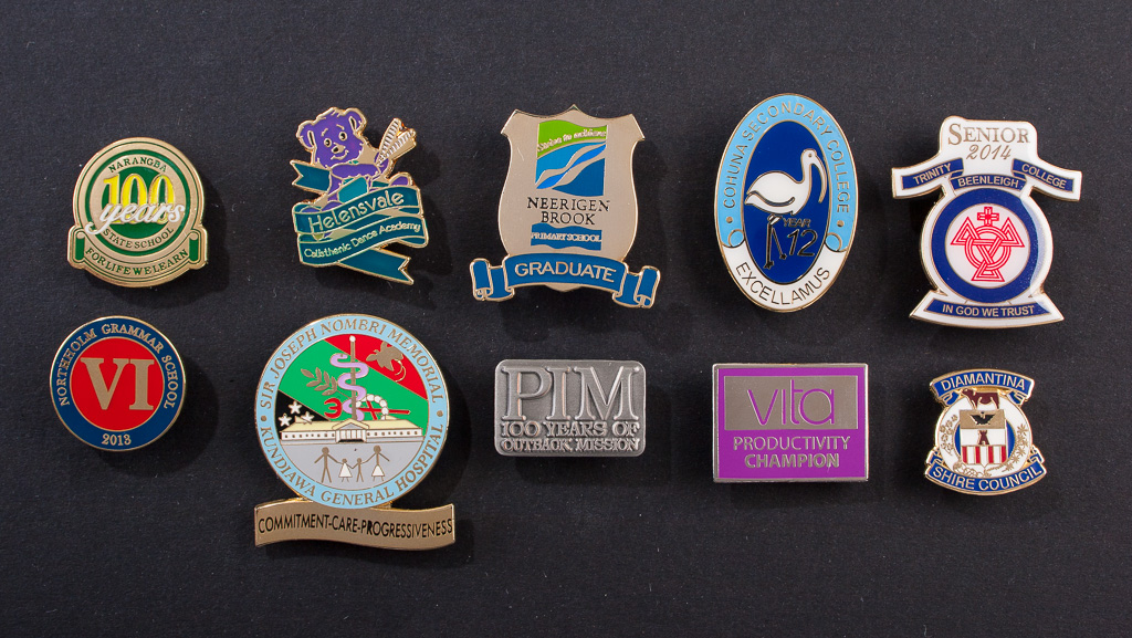 Various custom metal badge designs.