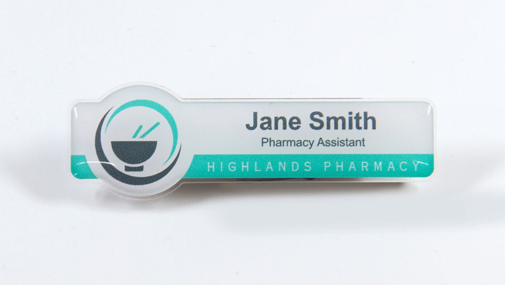 Custom shaped pharmacy assistant name badge.