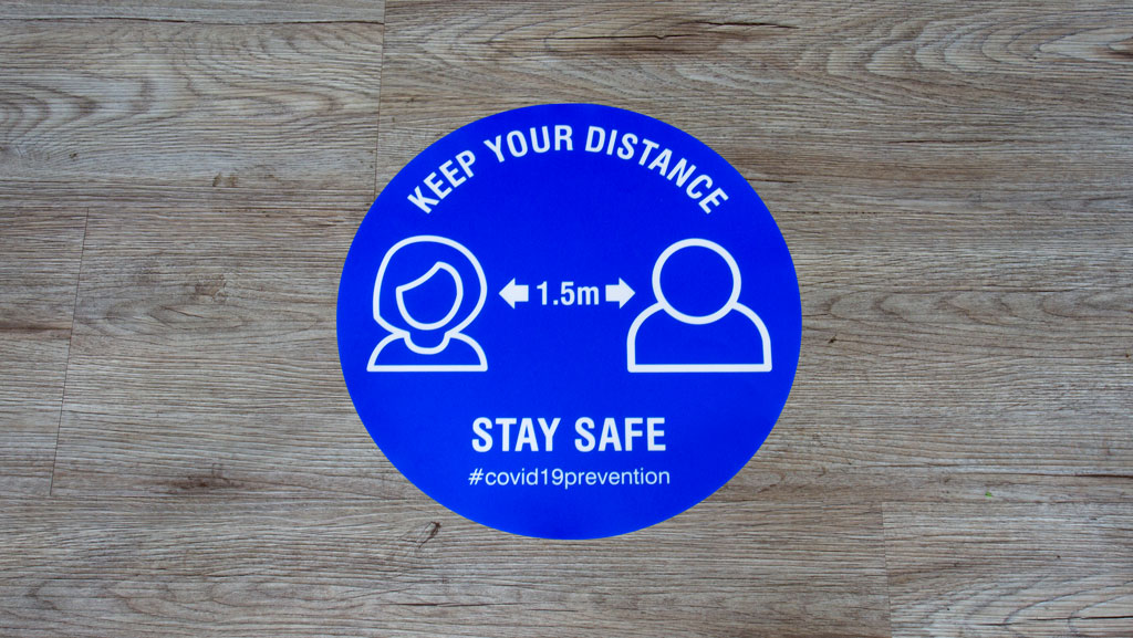 Keep your distance floor sticker.