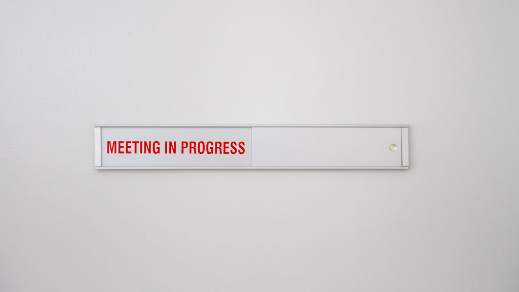 "A door sign that can show if ""Meeting In Progress"" or ""Vacant"" a great option for your business. This manufactured in Australia item can be personalised to your business needs."