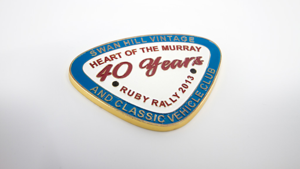 Made to order triangle shaped vintage rally club metal badge.