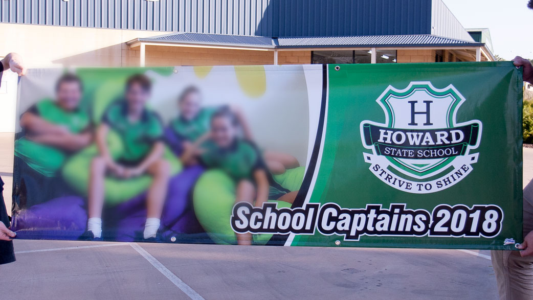 An outdoor banner showing the latest school captains at the time.