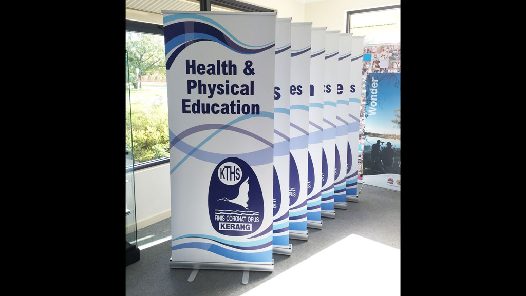 Custom pull up banners in a line. Manufactured here in Australia.