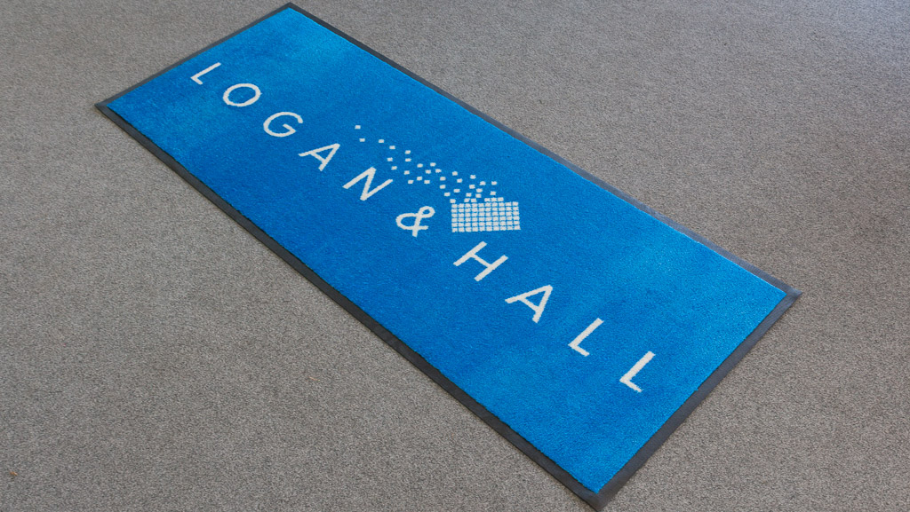 Custom sized logo floor mat for a business.