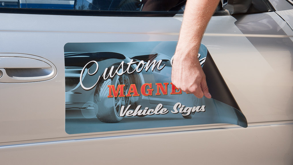 Digitally printed magnetic vehicle sign.