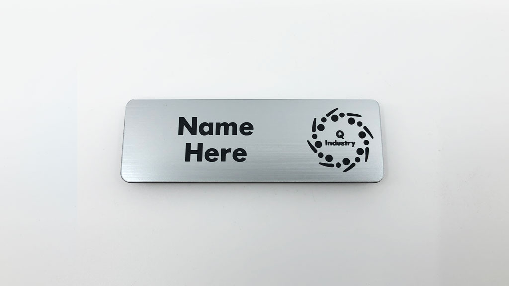 Custom engraved name tag. Brushed silver with black.