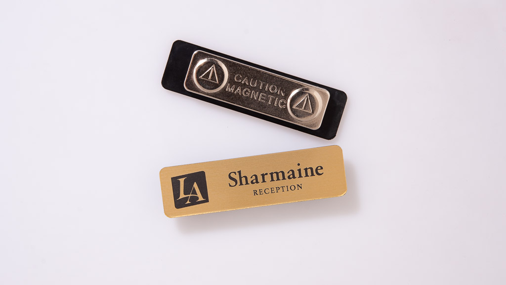 Name badge with magnetic back and a gold face for a hotel.