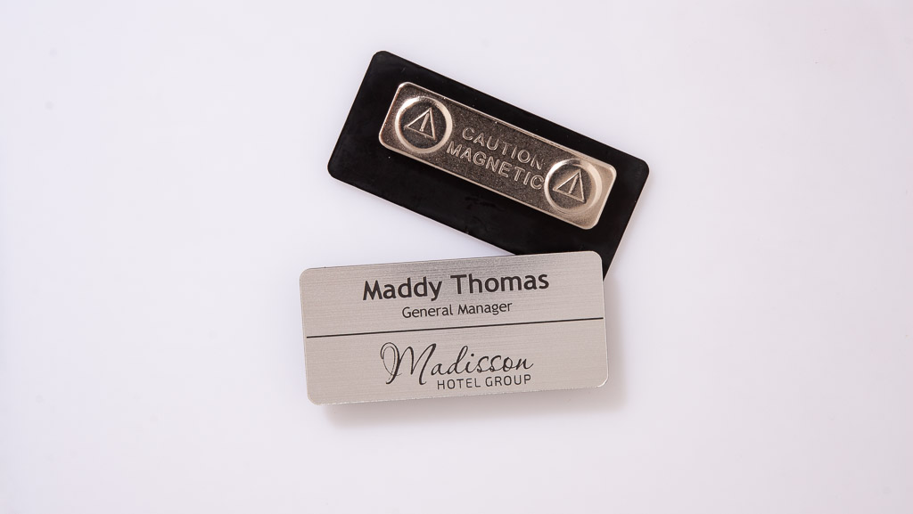 Engraved hotel name badge.