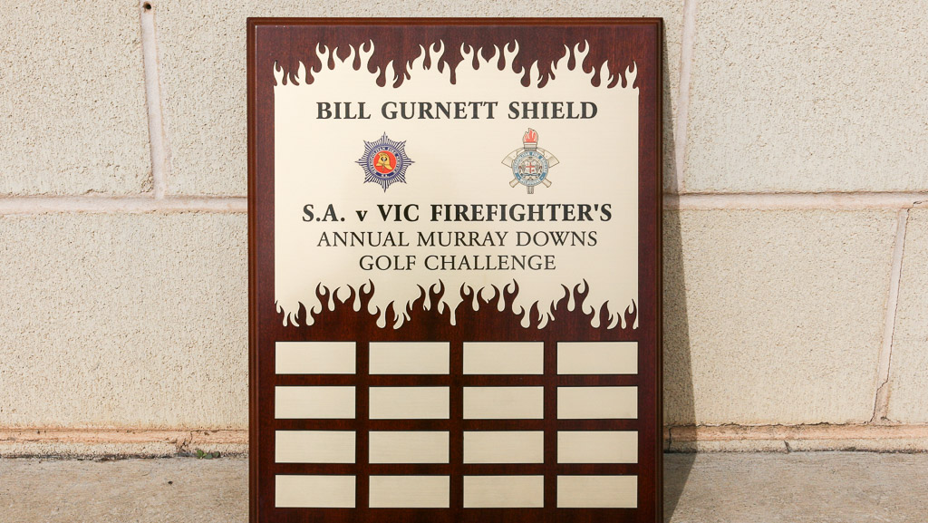 Firefighters custom perpetual trophy plaque. Wood and gold coloured.