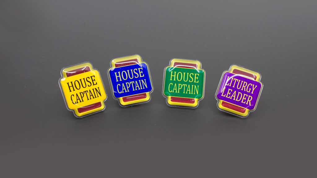 School captain badges in various colours and designs. Including a Liturgy Leader badge.