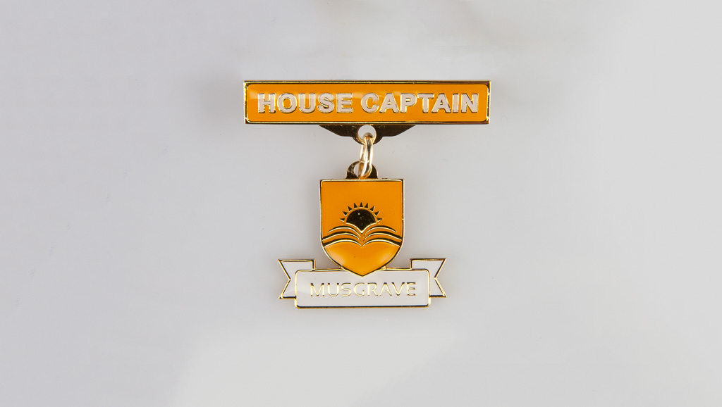 "A custom designed metal ""House Captain"" badge manufactured for a school in Australia."