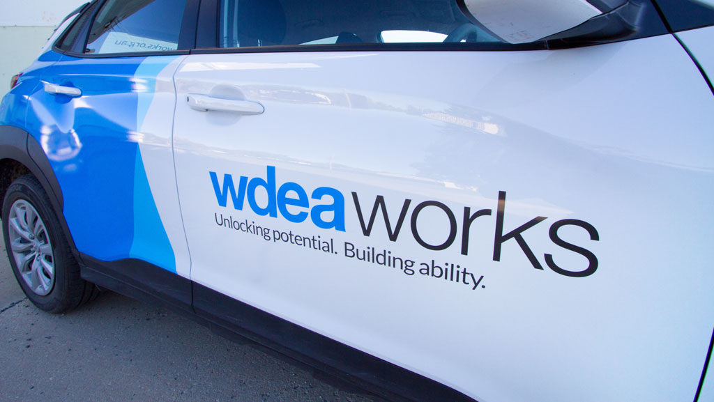 Cropped photo of door signage of wdea works.