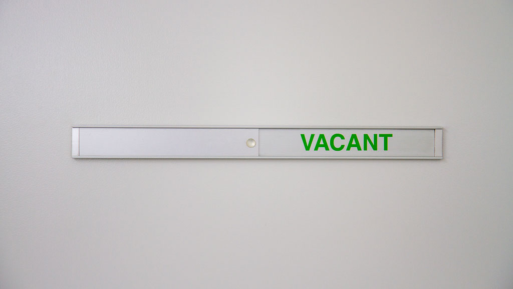 "A flush mount ""Vacant"" and ""In Use"" door sign, that can have custom text if needed."