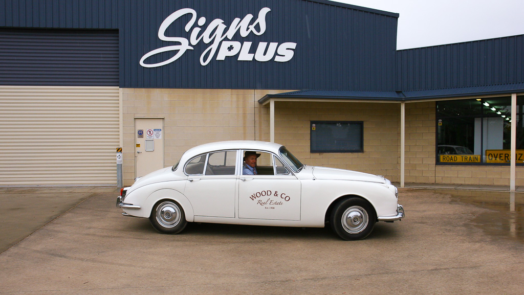 Side view of a Jaguar Mark II pictured with custom vehicle graphics on the door.
