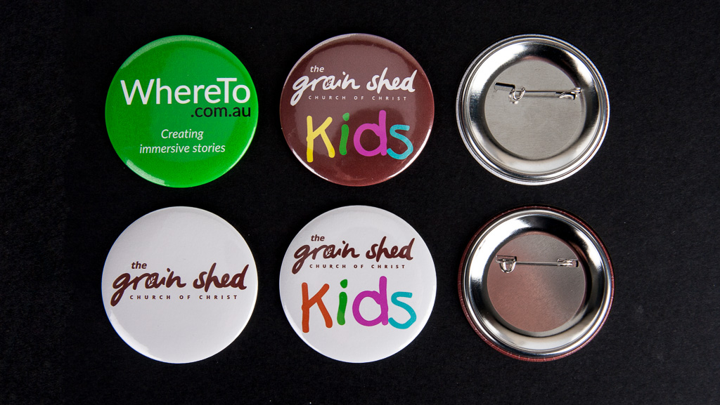 6 large 58mm diameter button badges