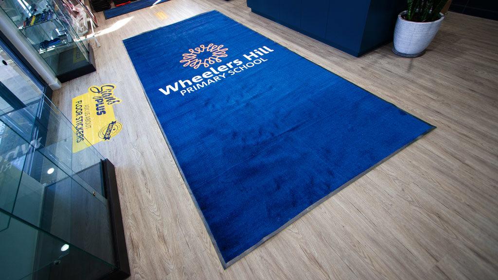 An extra large custom logo mat.