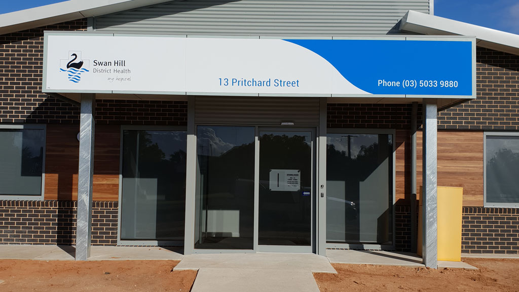 Large sign for Swan Hill District Health at 13 Pritchard Street, Swan Hill.