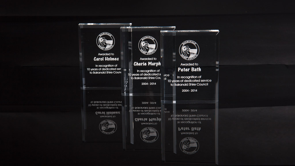 Several customised laser engraved acrylic council awards.