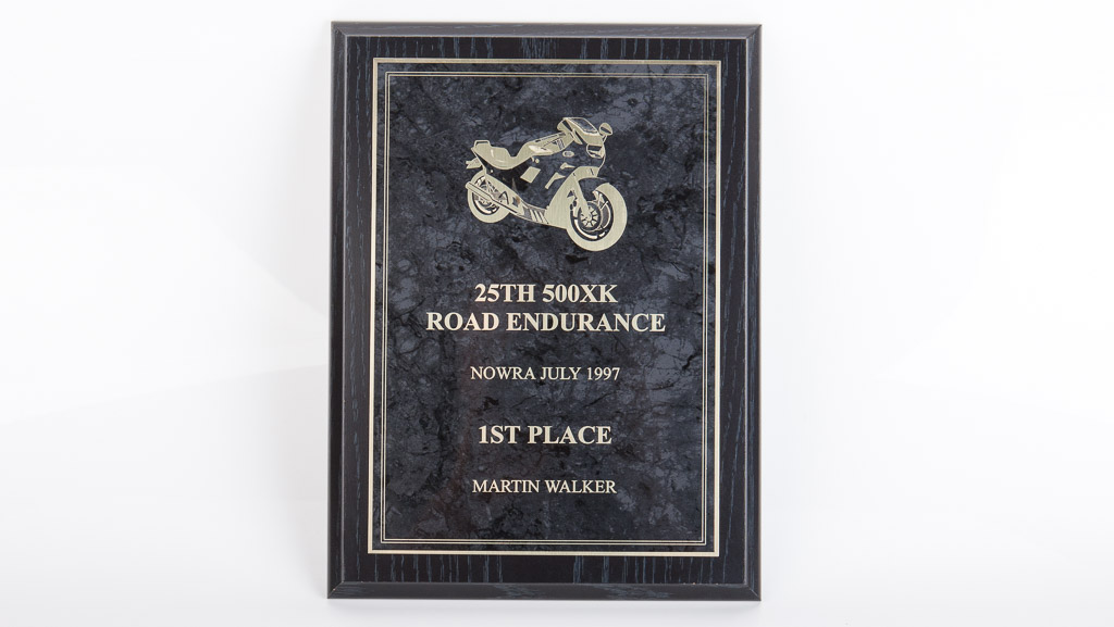 Road endurance 1st place award plaque. Slightly traditional in style with modern elements. Laser engraved coated brass award plaque