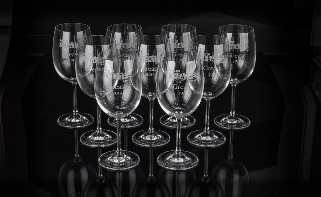 Laser engraved memorial wine glasses.