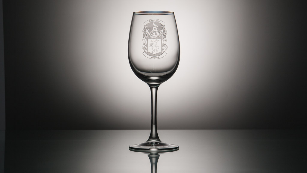 One custom engraved crest on glass.