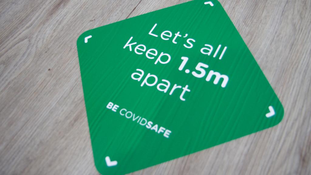 Covid 19 safety floor sticker.