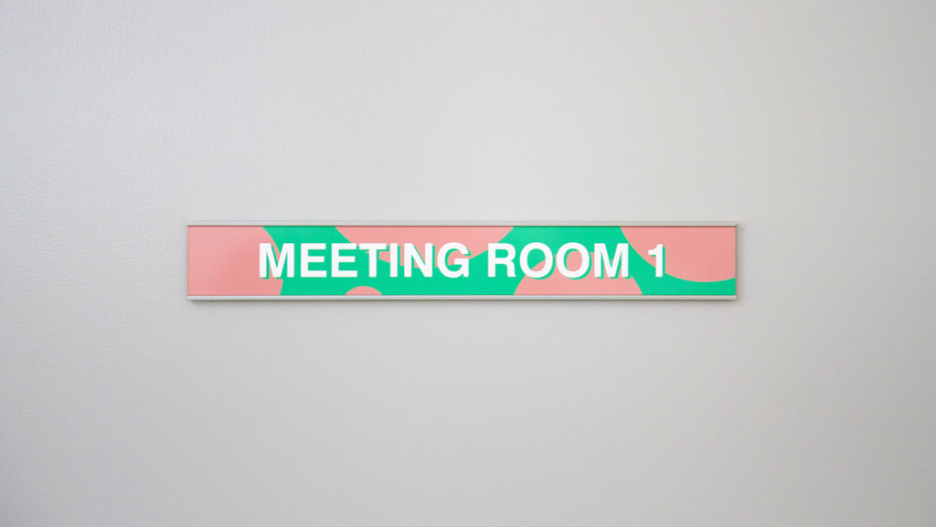 "Custom door sign for ""Meeting Room 1"" that can be used on the exterior of your office."