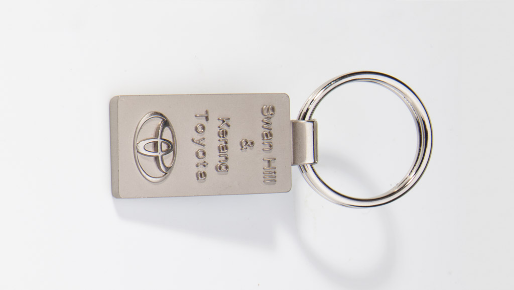 Toyota dealership metal key tag.