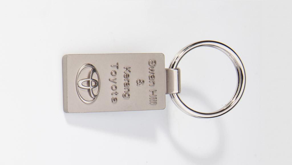 Toyota dealership metal key tag.