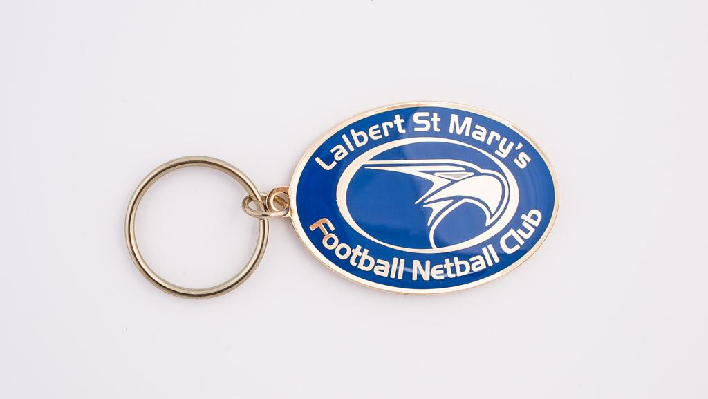 Custom manufactured key tag for a football netball club.