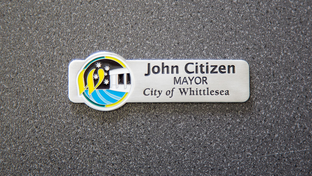 Custom manufactured metal name tag badge.