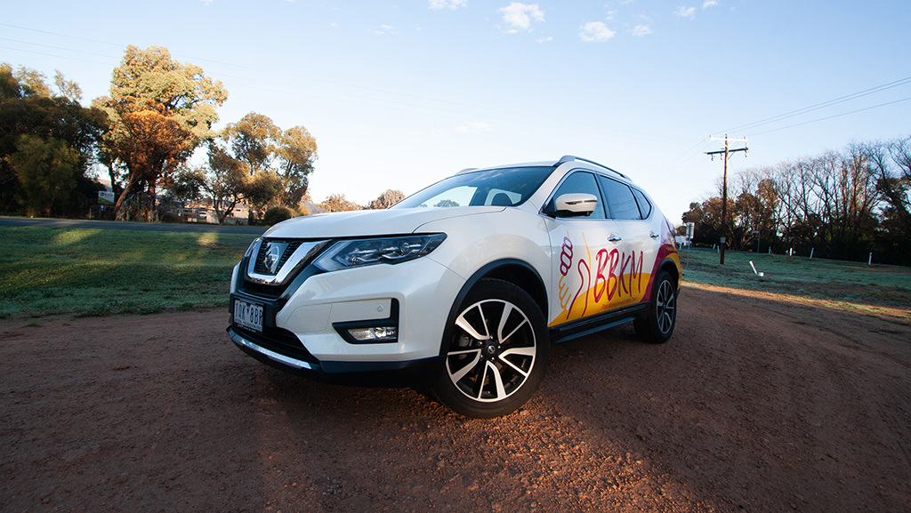 Vehicle wrap signage for a new Nissan X-Trail.