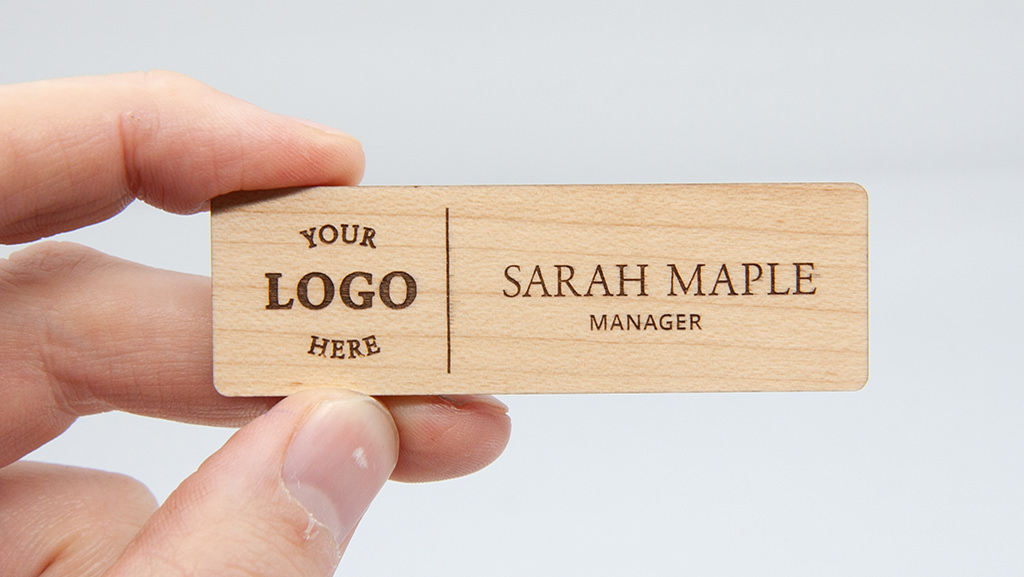 Personalised wooden name badge with logo.