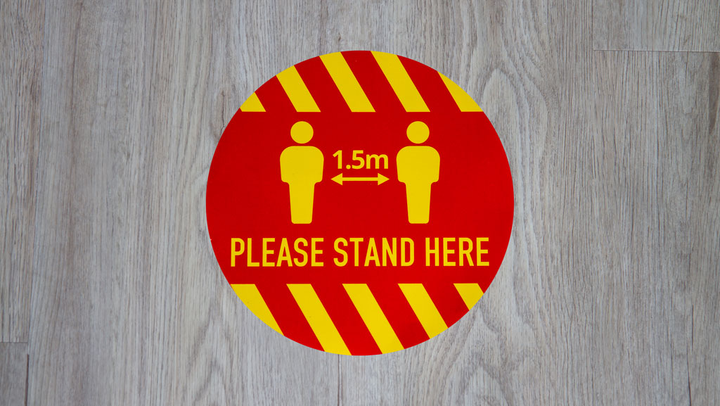 Please stand here social distancing sticker.