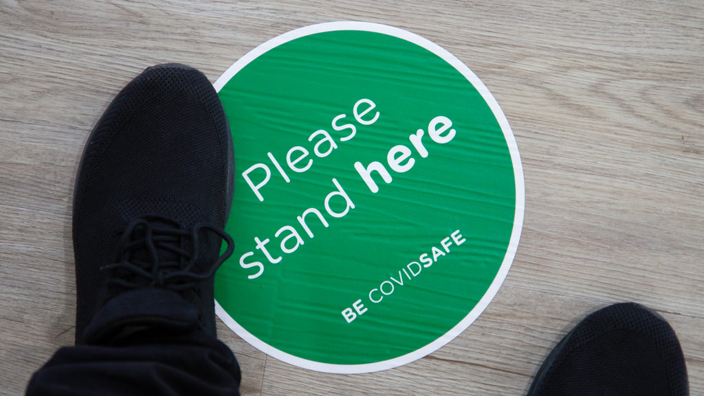Please stand here BE COVIDSAFE round shaped floor sticker.